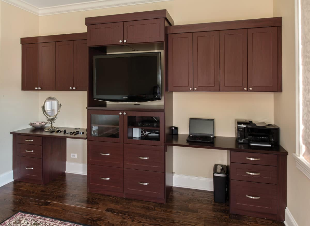 bedroom media center with desk for him and vanity for her